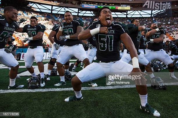 Lance Williams of the Hawaii Warriors and teammates perform 'haka' before the start of the first quarter of a NCAA game against the Nevada Wolfpack...