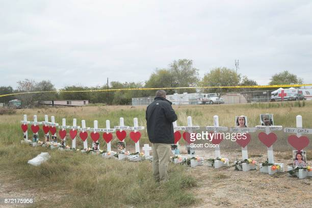 Lance Willis looks over a memorial where 26 crosses were placed to honor the 26 people killed at the First Baptist Church of Sutherland Springs on...