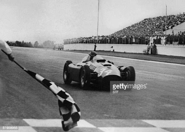 LanciaFerrari D50 driver Juan Manuel Fangio crosses the finish line of the Argentina's Grand Prix and wins 22 January 1956 in Buenos Aires AFP PHOTO