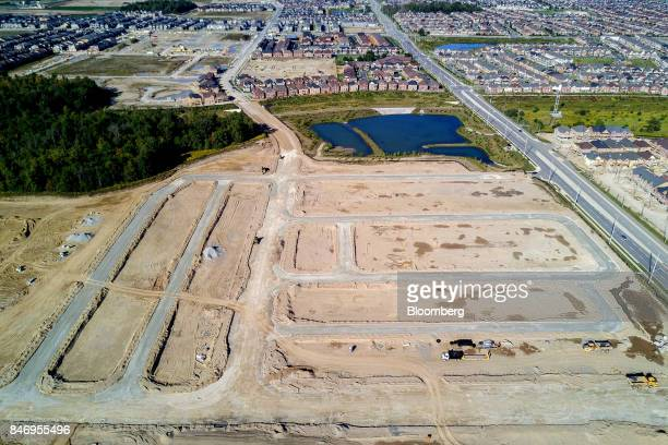 Land allotted for new homes near a construction site in this aerial photograph taken above Brampton Ontario Canada on Saturday Sept 9 2017 Toronto...