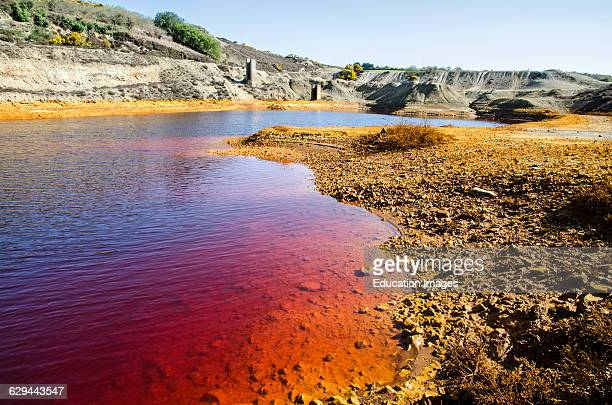 Land and water contaminated by industrial waste disposal.
