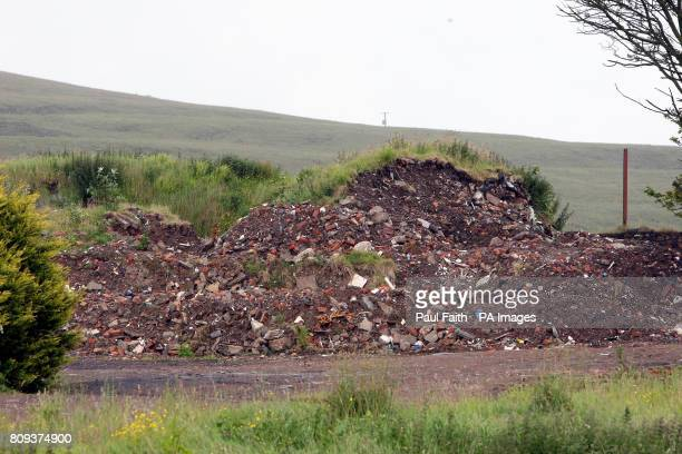 Land at Ballyutoag Road on the northern outskirts of Belfast city as a skip hire boss was detained today as part of an investigation into the illegal...
