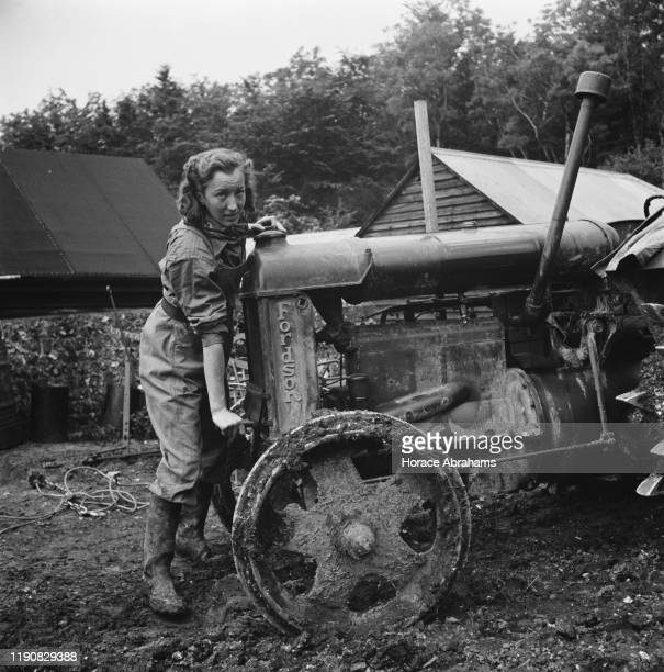 A Land Girl with a Fordson tractor in Sussex England during World War II June 1941