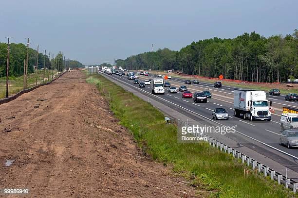 Land is leveled next to the New Jersey Turnpike near Chesterfield New Jersey US on Friday May 14 2010 New Jersey the thirdmost indebted US state sold...