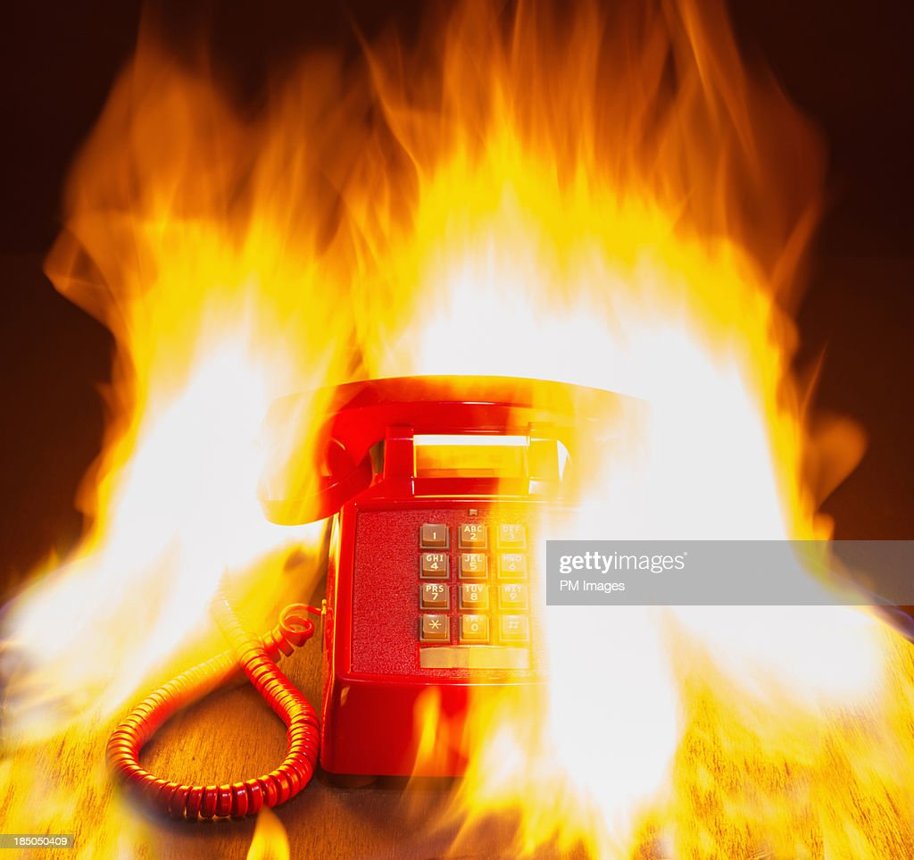 Land line phone on fire : Stock Photo