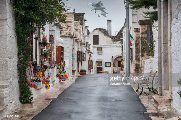 land of the trulli - trulli stock photos and pictures