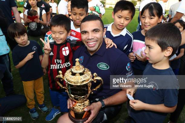 Land Rover ambassador Bryan Habana poses with the Webb Ellis Cup during an Impact Beyond Rugby Introduction Day event for Rugby World Cup 2019™...