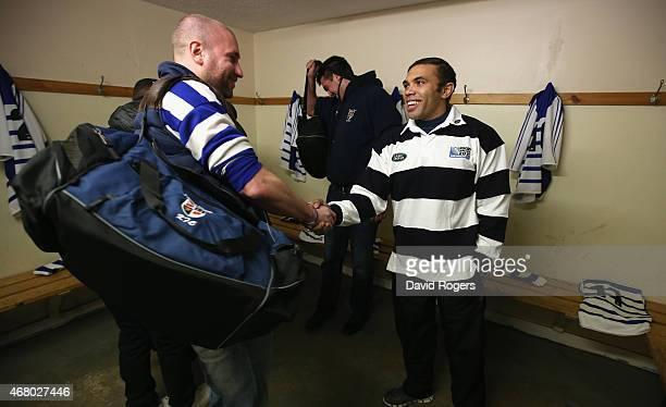 Land Rover ambassador Bryan Habana welcomes a player form Racal Decca RFU during the launch of the Land Rover Rugby World Cup 2015 We Deal In Real...