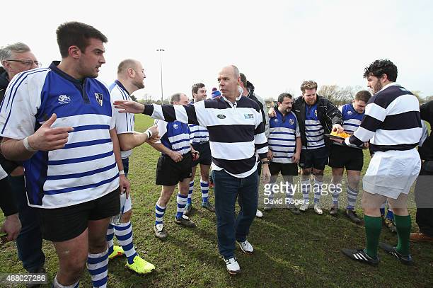 Land Rover ambassador Sir Clive Woodward talks to the players from Racal Decca RFC during the half time break during the launch of the Land Rover...