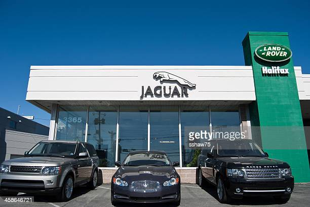 land rover and jaguar vehicles outside of dealership - range rover stock pictures, royalty-free photos & images
