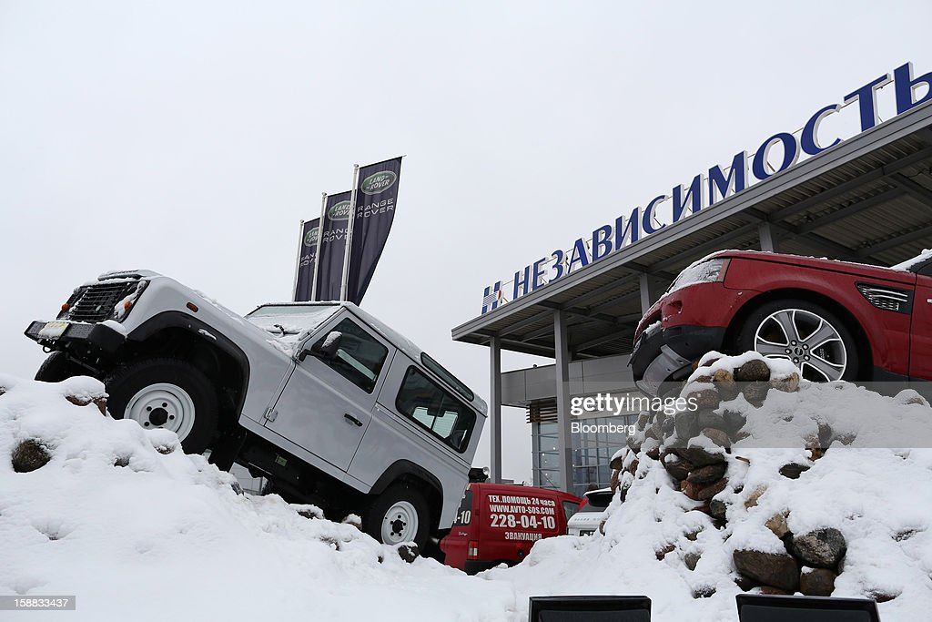Land Rover automobiles stand on display surrounded by snow outside an independent auto showroom in Moscow, Russia, on Friday, Dec. 28, 2012. Tata Motors Ltd.'s Jaguar Land Rover luxury unit signed a letter of intent with Saudi Arabia's government to study the feasibility of setting up a factory to build its models locally. Photographer: Andrey Rudakov/Bloomberg via Getty Images