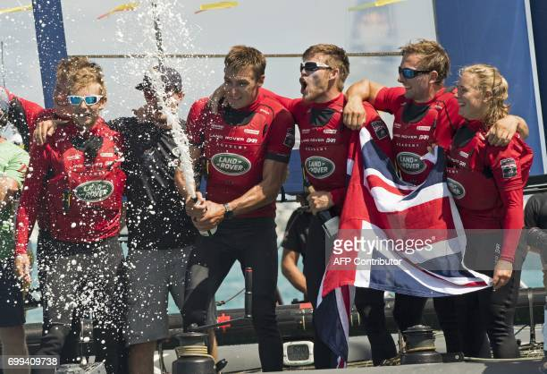 Land Rover Bar Academy team from Great Britain celebrate after winning the Red Bull Youth Americas Cup June 21 2017 in Hamilton Bermuda Teams from...