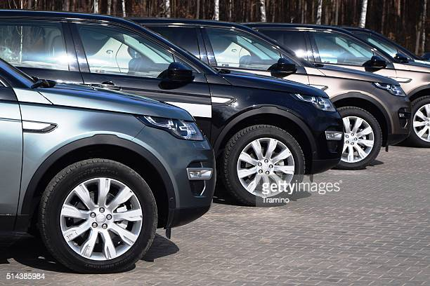 land rover cars in a row - land rover stock pictures, royalty-free photos & images
