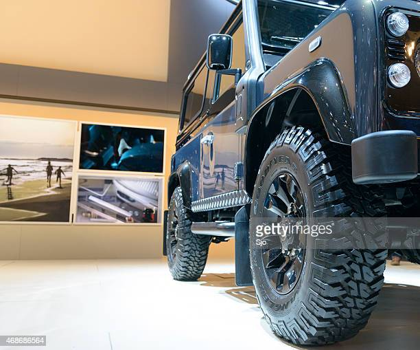 land rover defender 90 station wagon low angle front view - defending stock pictures, royalty-free photos & images