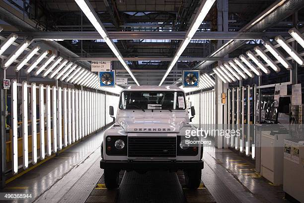 A Land Rover Defender automobile moves down the inspection line at Tata Motors Ltd's Jaguar Land Rover vehicle manufacturing plant in Solihull UK on...