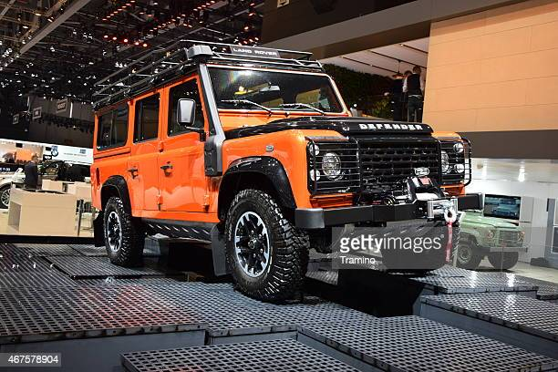 land rover defender on the motor show - land rover stock pictures, royalty-free photos & images