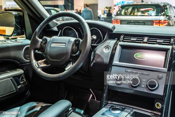 Land Rover Discovery luxury offroad SUV dashboard on display at Brussels Expo on January 9, 2020 in Brussels, Belgium.The car is equipped with a...