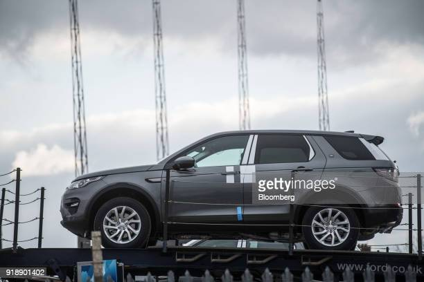 A Land Rover Discovery Sport sport utility vehicle sits on a transporter outside Jaguar Land Rover Plc's assembly plant a unit of Tata Motors Ltd in...