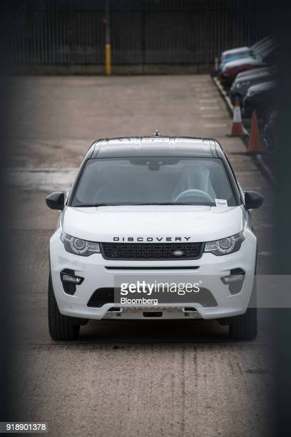 A Land Rover Discovery Sport sport utility vehicle sits outside Jaguar Land Rover Plc's assembly plant a unit of Tata Motors Ltd in Halewood UK on...
