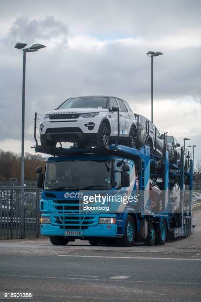 Land Rover Discovery Sport sport utility vehicles sit on a transporter outside Jaguar Land Rover Plc's assembly plant a unit of Tata Motors Ltd in...