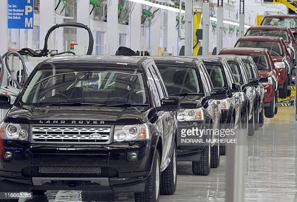 Land Rover Freelander II SUV vehicles are seen on the assembly line at the Jaguar Land Rover manufacturing plant in Pimpri at the western Indian...