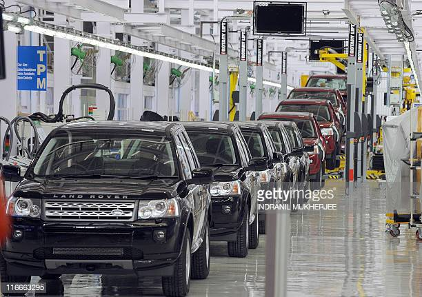 Land Rover Freelander II SUV vehicles are seen on the assembly line at the Jaguar - Land Rover manufacturing plant in Pimpri, at the western Indian...