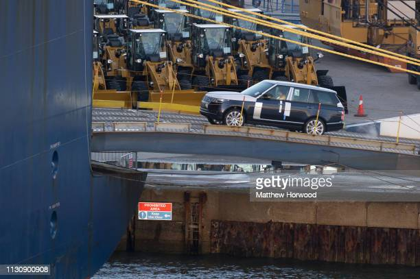 Land Rover made by British multinational car manufacturer Jaguar Land Rover is driven on to a container ship at the Port of Southampton on February...