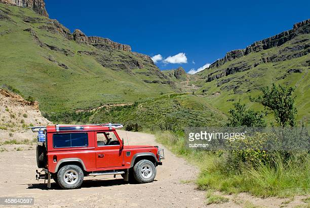 land rover parked at the bottom of sani pass - land rover stock pictures, royalty-free photos & images