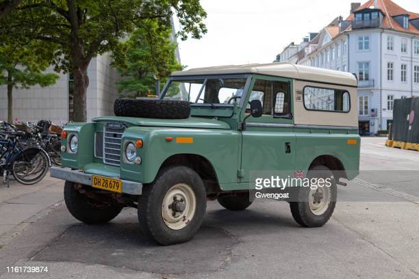 land rover series iii in a street of copenhagen - land rover stock pictures, royalty-free photos & images