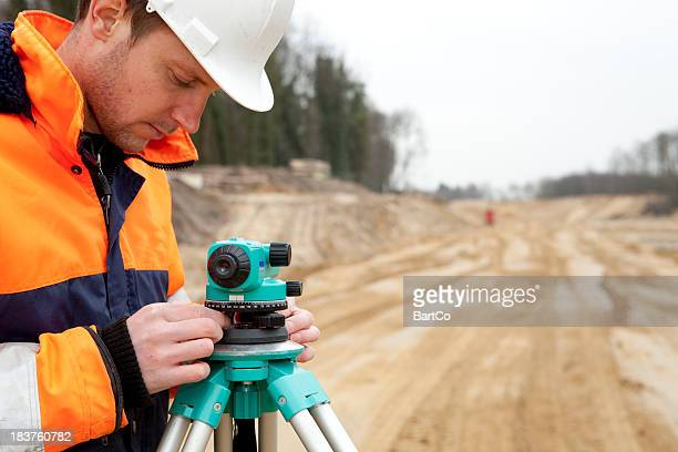 Land surveyor on construction site The Netherlands