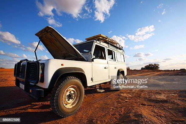 Land Vehicle With Sky In Background