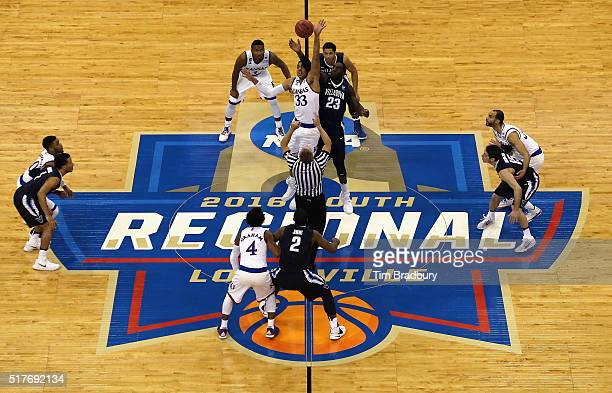 Landen Lucas of the Kansas Jayhawks and Daniel Ochefu of the Villanova Wildcats battle for the opening tipoff during the 2016 NCAA Men's Basketball...