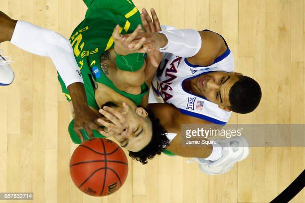 Landen Lucas of the Kansas Jayhawks and Dillon Brooks of the Oregon Ducks battle for the ball in the first half during the 2017 NCAA Men's Basketball...