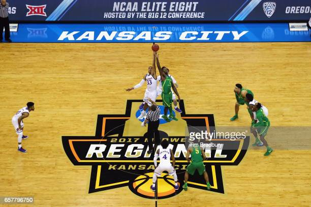 Landen Lucas of the Kansas Jayhawks and Jordan Bell of the Oregon Ducks jump for the opening tipoff during the 2017 NCAA Men's Basketball Tournament...