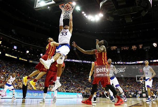 Landen Lucas of the Kansas Jayhawks goes up against Georges Niang of the Iowa State Cyclones in the first half during the championship game of the...