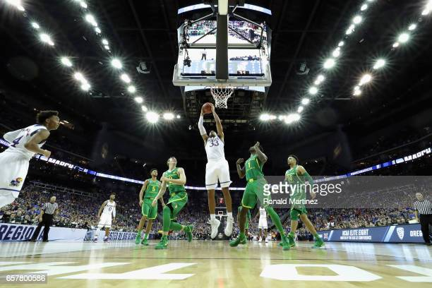 Landen Lucas of the Kansas Jayhawks handles the ball in the first half against the Oregon Ducks during the 2017 NCAA Men's Basketball Tournament...
