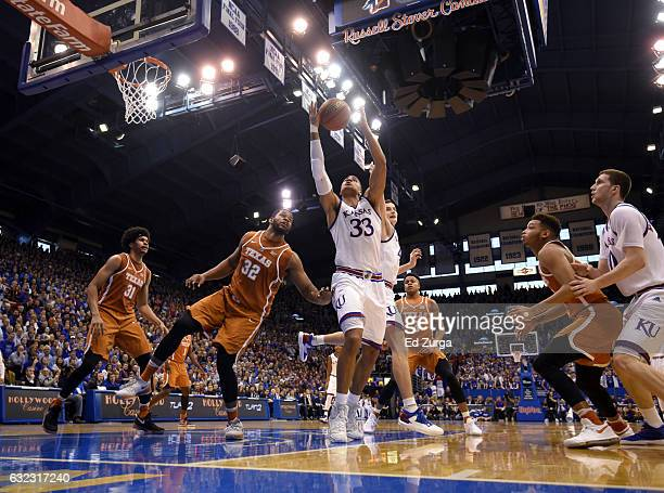 Landen Lucas of the Kansas Jayhawks rebounds against Jarrett Allen and Shaquille Cleare of the Texas Longhorns in the first half at Allen Field House...
