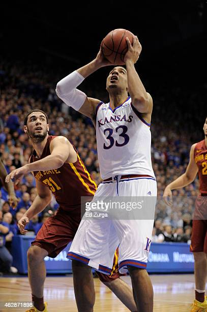 Landen Lucas of the Kansas Jayhawks shoots against Georges Niang of the Iowa State Cyclones at Allen Field House on February 2 2015 in Lawrence Kansas