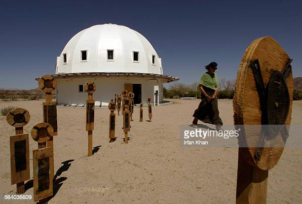 Landers April 12 2006 – – – Integratron stands among Alien Men in foreground created by an artist Johnette Napolitano Nancy Karl walks by on right...