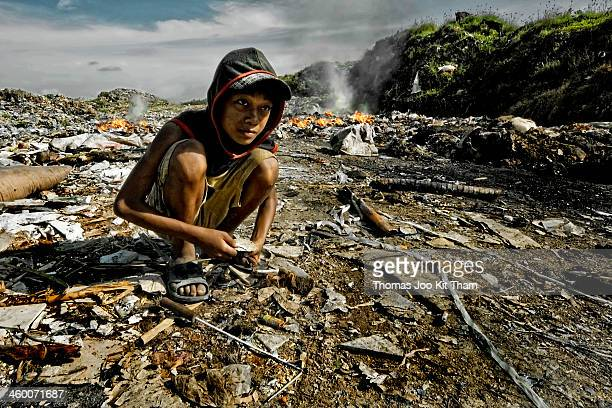 CONTENT] landfill dumpsite garbage rubbish Cambodia Phnom Penh scavenger boy kid child poverty