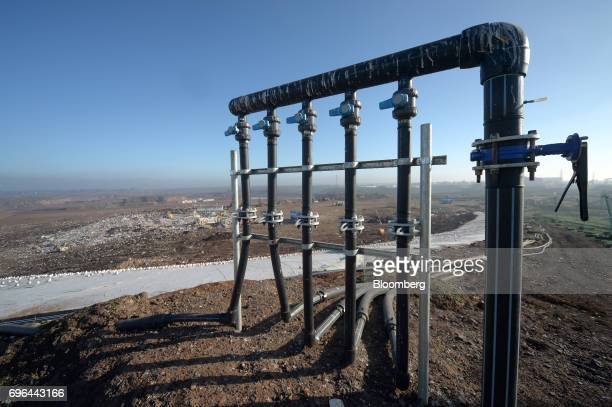 A landfill gas extraction wellhead stands at the perimeter of an open landfill cell at the Melbourne Regional Landfill site operated by at...