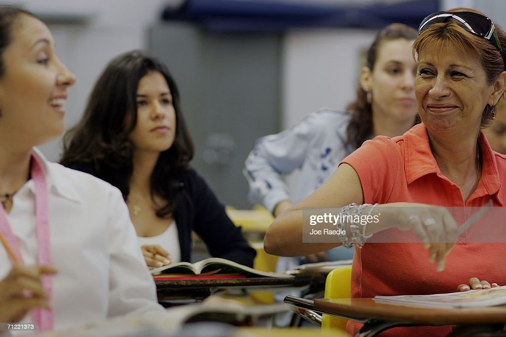 Landi Rojas, originally from Ecuador, Carolina Montilla, originally from Venezuela, and Maria Hidalgo, originally from Peru, during English class at the English Center June 16, 2006 in Miami, Florida. The school holds adult education classes that include English language classes for people who have immigrated to the United States. U.S. President George W. Bush recently said, ?Part of the greatness of America is that we've been able to help assimilate people into our society... And part of that assimilation process is English. I believe this: If you learn English, and you're a hard worker, and you have a dream, you have the capacity from going from picking crops to owning the store, or from sweeping office floors to being an office manager.?