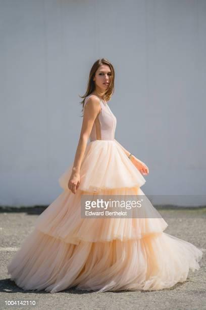 Landiana Cerciu Vice President of Feeric Fashion Week wears a pink lace ruffled dress during Feeric Fashion Week 2018 on July 22 2018 in Sibiu Romania