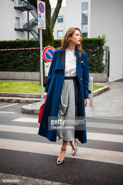 Landiana Cerciu wearing a blue jacket and a red bag is seen outside Giorgio Armani show during Milan Fashion Week Fall/Winter 2018/19 on February 24,...