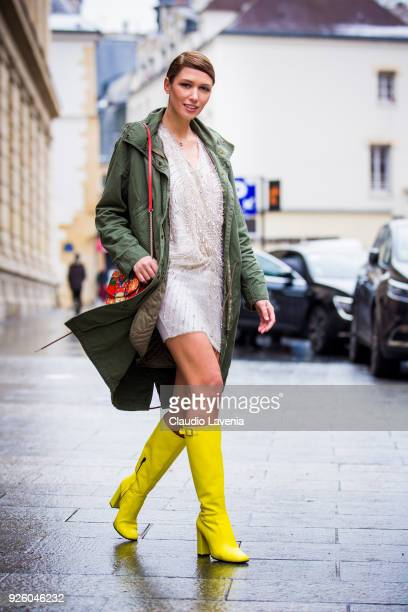 Landiana Cerciu wearing a green parka and yellow heels boots is seen in the streets of Paris before the Ann Demeulemeester show during Paris Fashion...