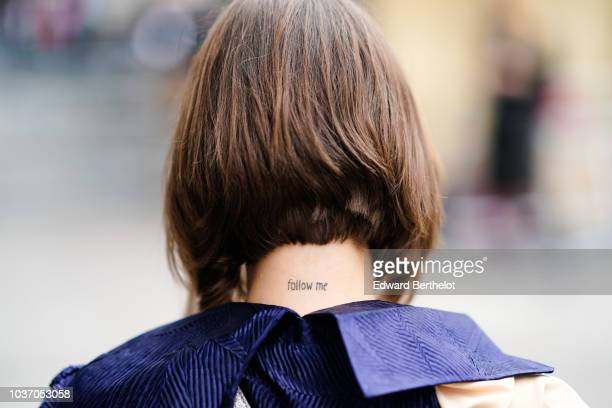 Landiana Cerciu wears a tattoo depicting the words Follow Me during London Fashion Week September 2018 on September 14 2018 in London England
