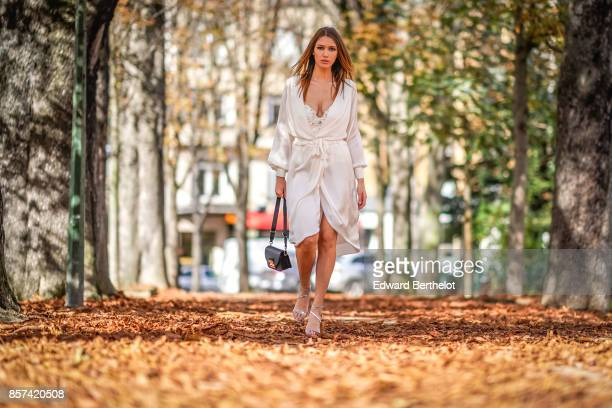 Landiana wears a white dress outside Moncler during Paris Fashion Week Womenswear Spring/Summer 2018 on October 3 2017 in Paris France