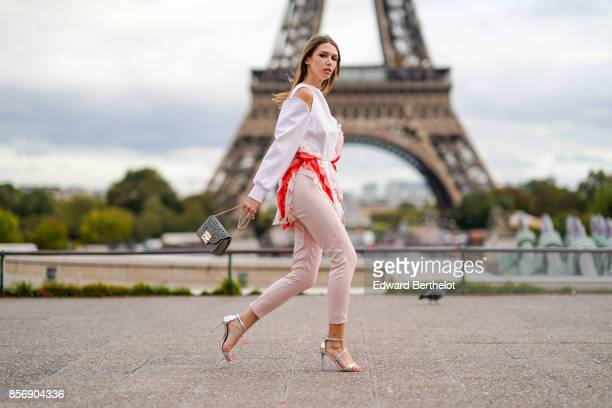 Landiana wears a white top pink pants a bag outside Hermes during Paris Fashion Week Womenswear Spring/Summer 2018 on October 2 2017 in Paris France