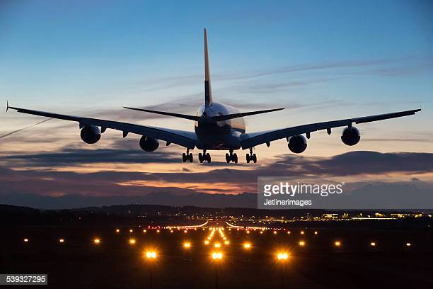 landing airplane - aeroplane stock photos and pictures