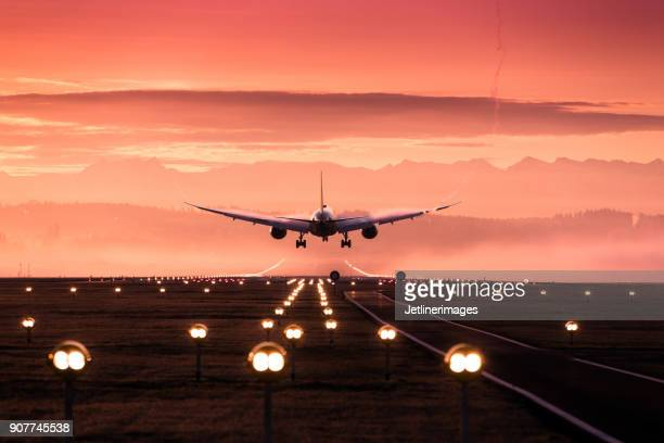 landing airplane - airport runway stock pictures, royalty-free photos & images